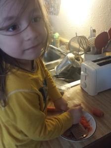 Elijah bug grating carrots