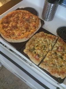 sausage tomato pizza and garlic chicken alfredo pizza